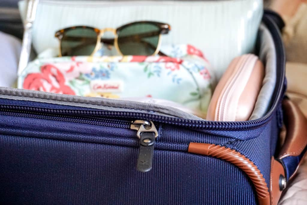 Looking for easy packing tips and ideas on how to save money by traveling with a carry-on only? Check out this helpful guide by a frequent traveler! #carryon #travel #travelpro #luggage #traveltips